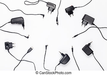 Power charger different adapters circle background, empty...