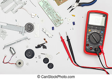 Engineering mess background with multimeter, electrical and...