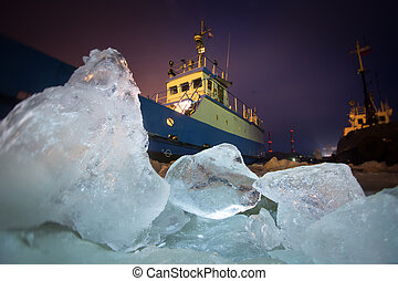 The Icebreaker ship trapped in ice tries to break and leave...