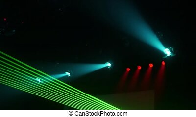 Green blinking beams from laser show in nightclub. Blue spolights