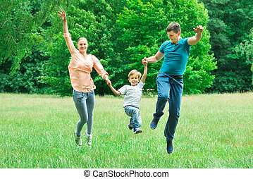Parents Jumping With Their Son
