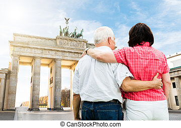 Couple Standing In Front Of Brandenburg Gate - Rear View Of...