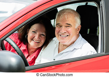 Couple Sitting In A Car