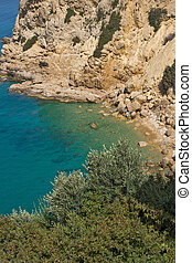 small beach in Thassos island - Seascape with blue waters in...