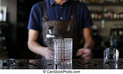 The bartender puts a whiskey in a cocktail - Bartender puts...