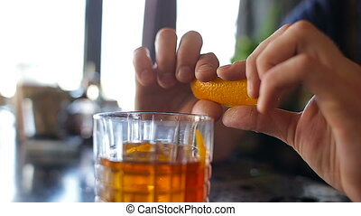 Orange garnish spray over a drink.