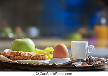 Breakfast with fresh fruits, boiled egg and coffee