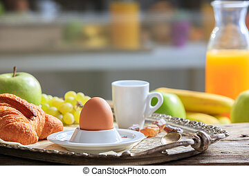 Breakfast with fresh fruits, egg and coffee