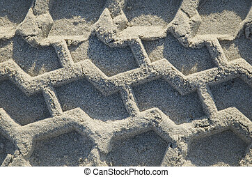 Car wheel track on the sand in the natural environment