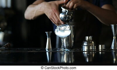 The bartender presses juice in cocktail