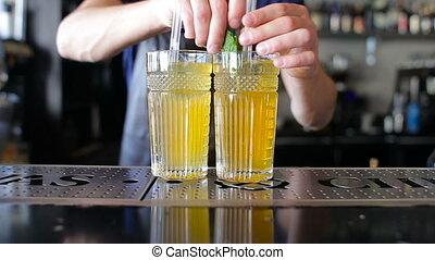 Bartender makes homemade lemonade at a restaurant - The...