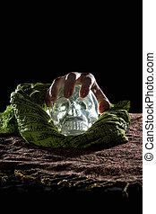 Hand Grabbing a Crystal Skull - Creepy hand grabbing a...