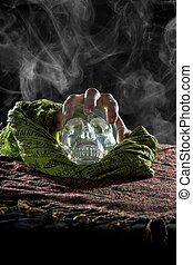 Hand Holding a Crystal Skull with Smoke - Spooky smoky scene...