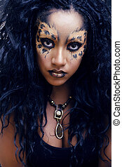 beauty afro girl with cat make up, creative leopard print...