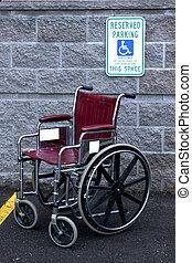 handicapped parking - empty wheelchair in a handicapped...