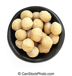 Macadamia Nuts in Black Bowl Overhead View Isolated