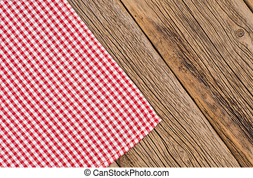 Rustic wooden boards with a red checkered tablecloth.