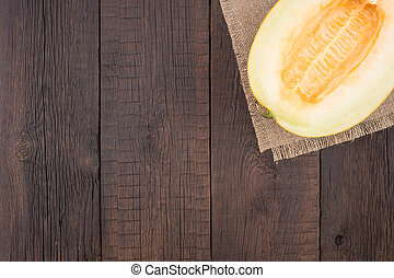 Melon on an old wooden table