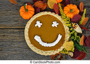 pumpkin pie with happy face - Pumpkin pie with happy face in...