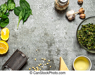 Different ingredients for Italian pesto. On the stone table.