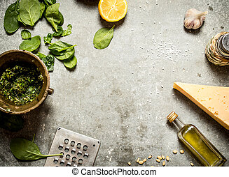Ingredients for pesto. On the stone table.