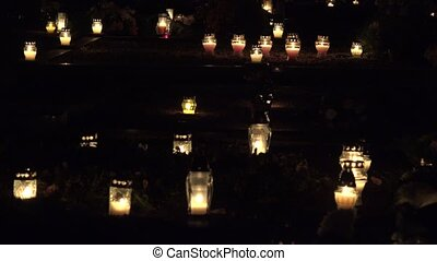 Flaming candles on the grave on All saints day 4K - Flaming...