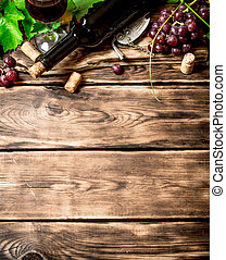 Red wine with a vine branch On a wooden table