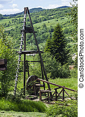 old oil derrick - old fashioned wooden oil pump of 19th...