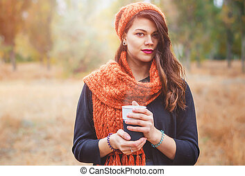 Young girl with a cup of coffee - Young beautiful girl with...