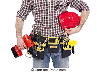 Tool belt - Carpenter wearing a tool belt and holding a...