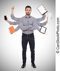 Multi-tasking man - Confident man with office supplies in...