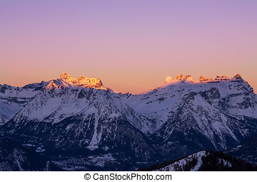 Just in time - The Moon sets behind the Dents du Midi in the...