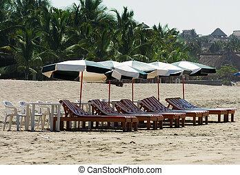Beach in Puerto Escondido, Mexico - Green beach umbrellas...