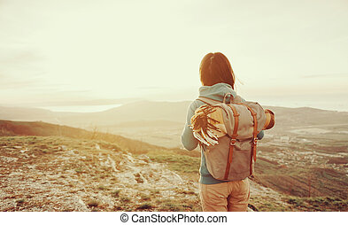 Tourist walking in mountains - Hiker young woman with...