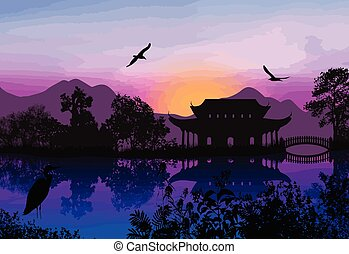 Beautiful asian landscape near water on idyllic sunset...