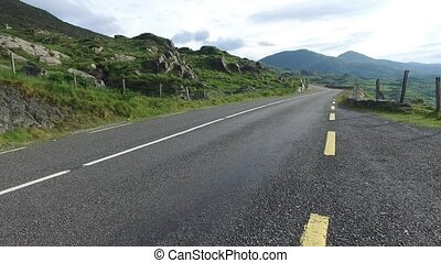 asphalt road at connemara in ireland 83 - travel and...