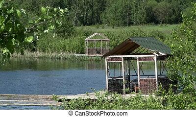 View of wicker gazebos on lake