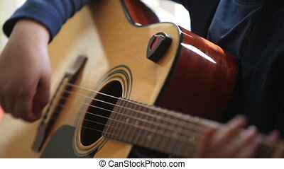 Little boy is playing the guitar HD