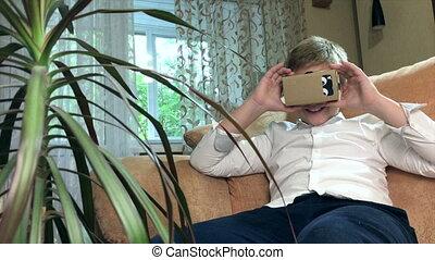 Boy wearing virtual reality goggles 4K - Boy wearing virtual...