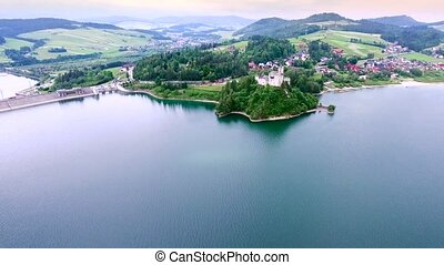 old castle on lake bank - aerial view of old castle on lake...