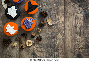 Halloween cupcakes on wooden background