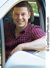 Portrait Of Man Driving Car