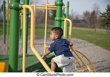 Multi-racial boy at the park - Cute multi-racial boy at the...