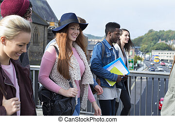 On our way to class! - A happy group of teenage students...