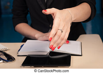 business woman stretches out hand for a handshake, close-up,