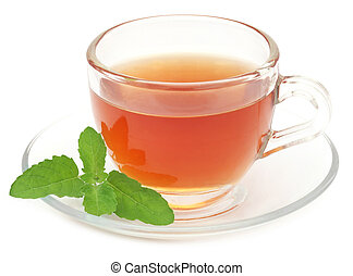 Herbal tea in a cup with tulsi leaves over white background