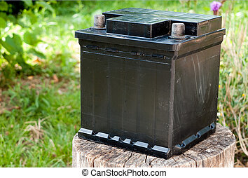 Abandoned old car battery - An old car battery on wooden...