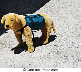 Puppy toy dog. - Puppy toy dog standing outside alone.