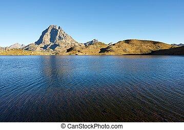 Pyrenees - Midi Dossau Peak reflected in Gentau lake. Ossau...