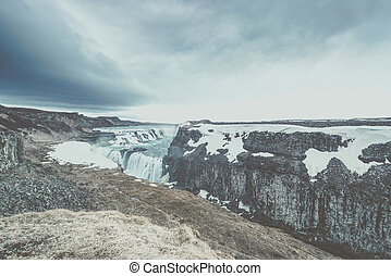 Gullfoss waterfall in Iceland - Gullfoss waterfall in cloudy...